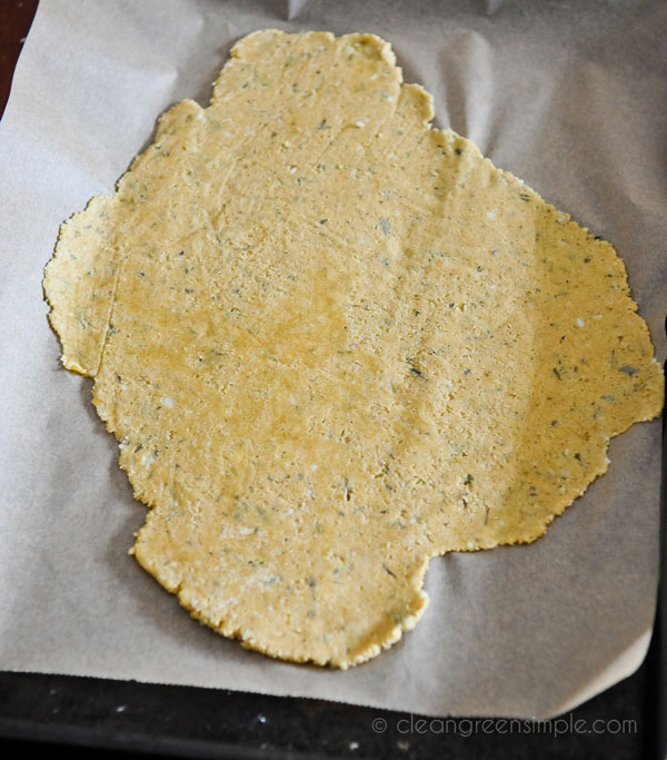 Rosemary crackers spread on pan