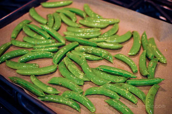 Sugar snap peas on a baking sheet