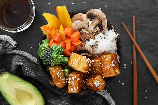 crispy teriyaki tofu bowl with sesame seeds