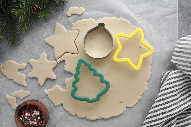 cutting out sugar cookies with cookie cutters