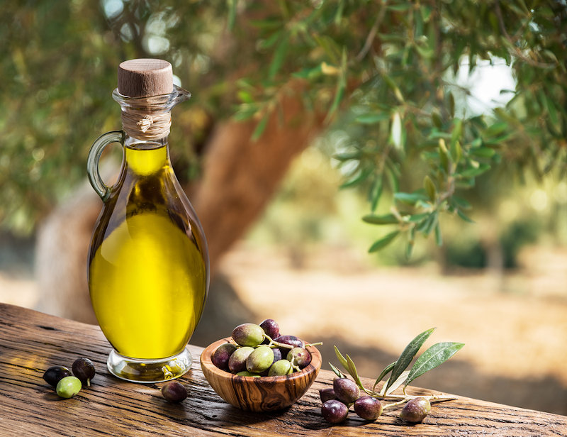 Bottle of olive oil, Kalamata olives, and olive tree