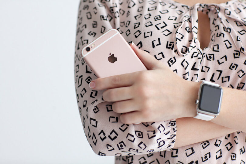 Woman With Apple Watch Holding Iphone