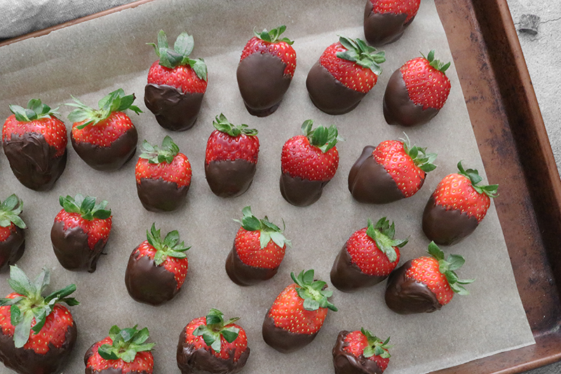 Vegan Chocolate Covered Strawberries on parchment paper