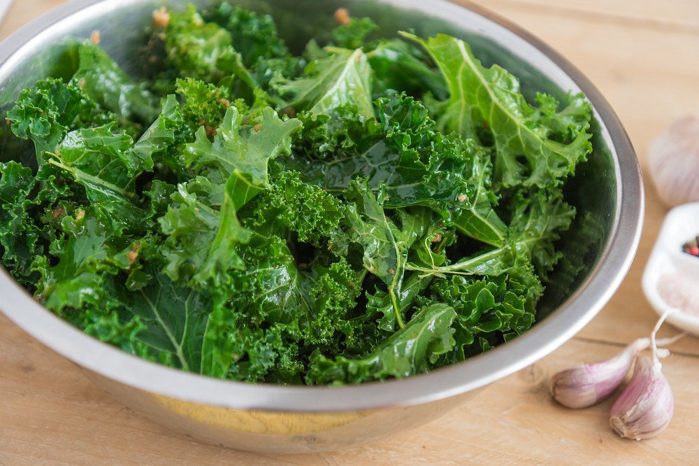 Kale in stainless steel bowl with garlic