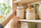 Woman taking jar of flour