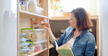 Woman In Pantry looking for food substitutions