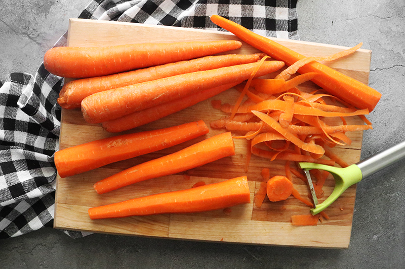 Peeled carrots on a cutting board
