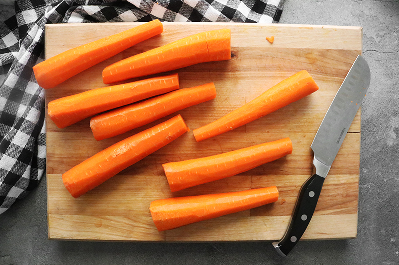 Carrots on a cutting board with a knife