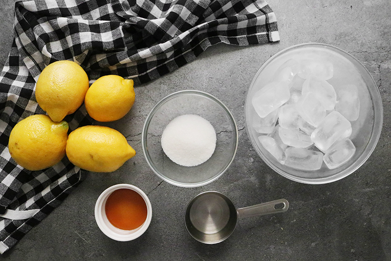 Frozen lemonade ingredients: lemons, water, ice, maple syrup