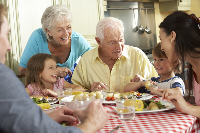 Family eating at table to celebrate Father's Day