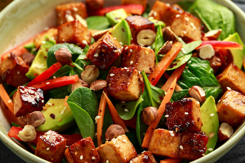 A tofu press was used to make this crispy vegan fried tofu salad
