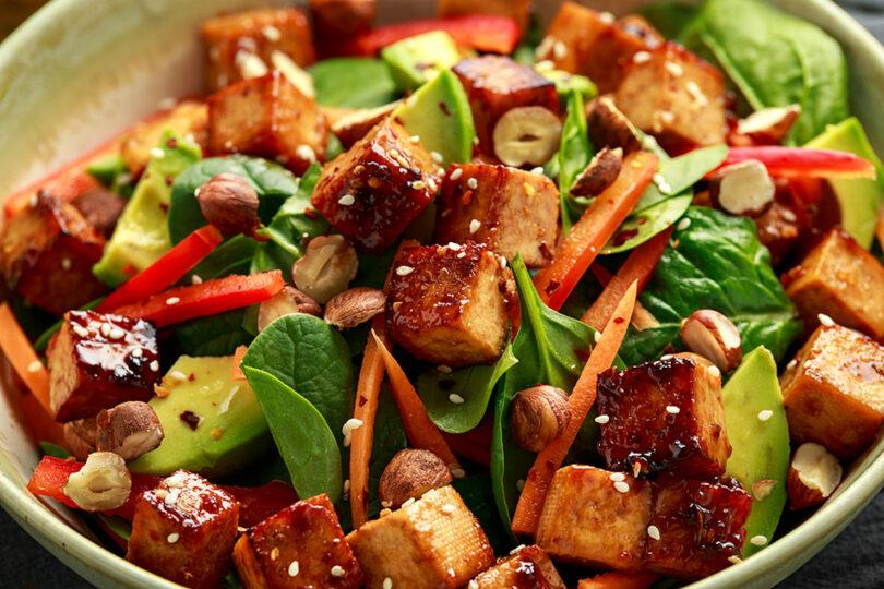 A tofu press was used to make this crispy vegan fried tofu salad