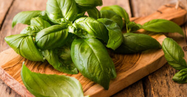 Genovese basil on a cutting board