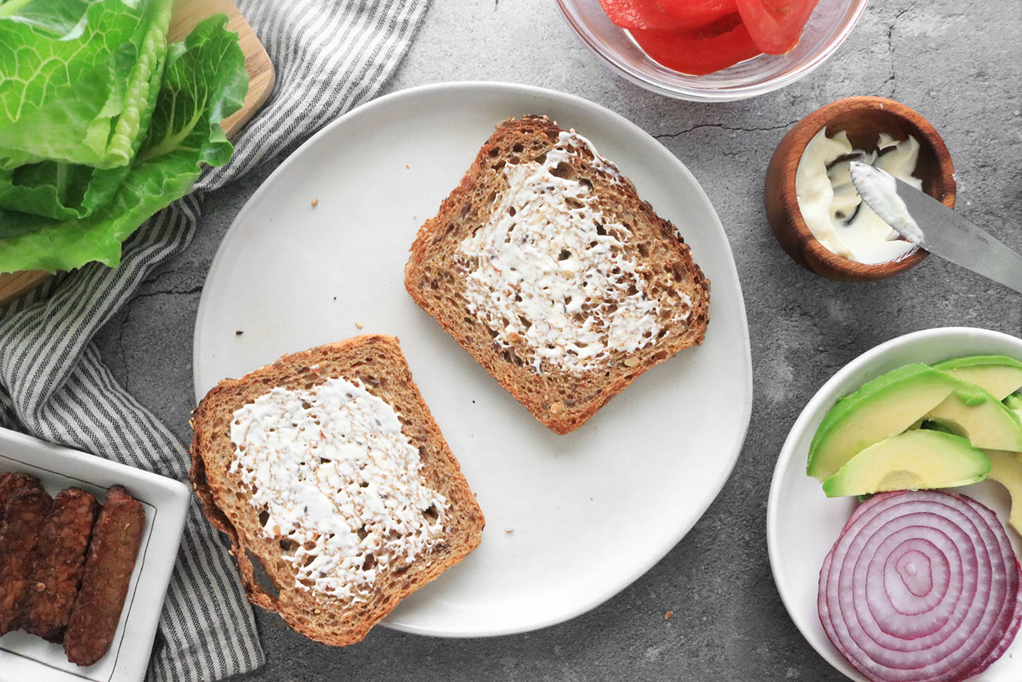 whole grain bread on a plate with mayonnaise