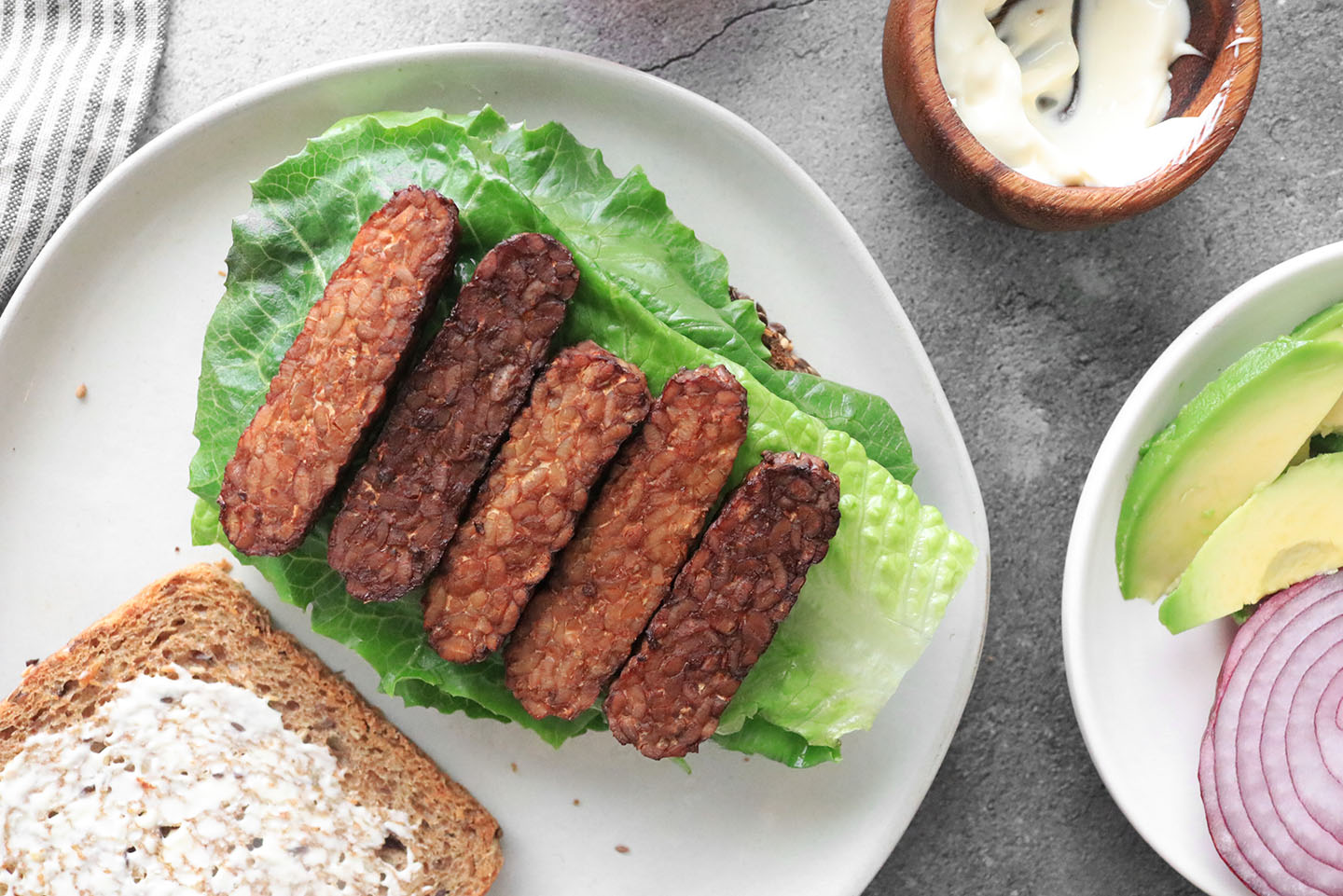 tempeh bacon on a bed of lettuce