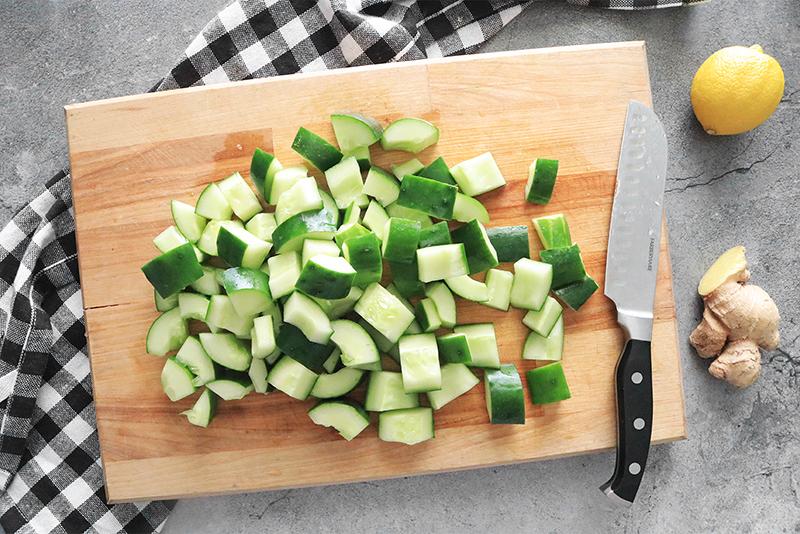 rough chopped cucumber on a cutting board