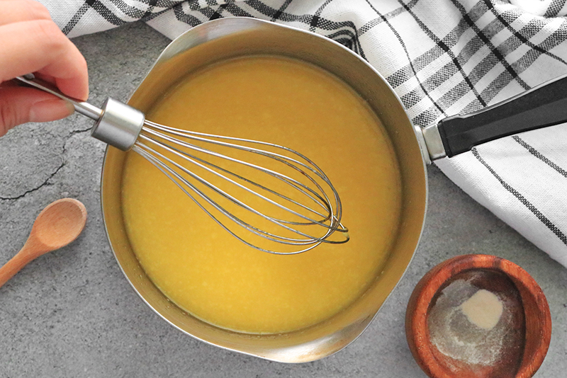 boiling fruit puree with vegan jello ingredients