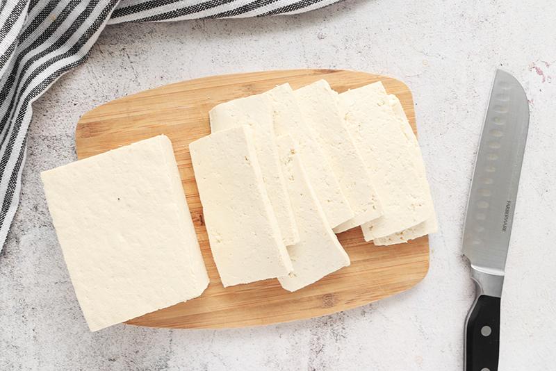 pressed tofu on a cutting board