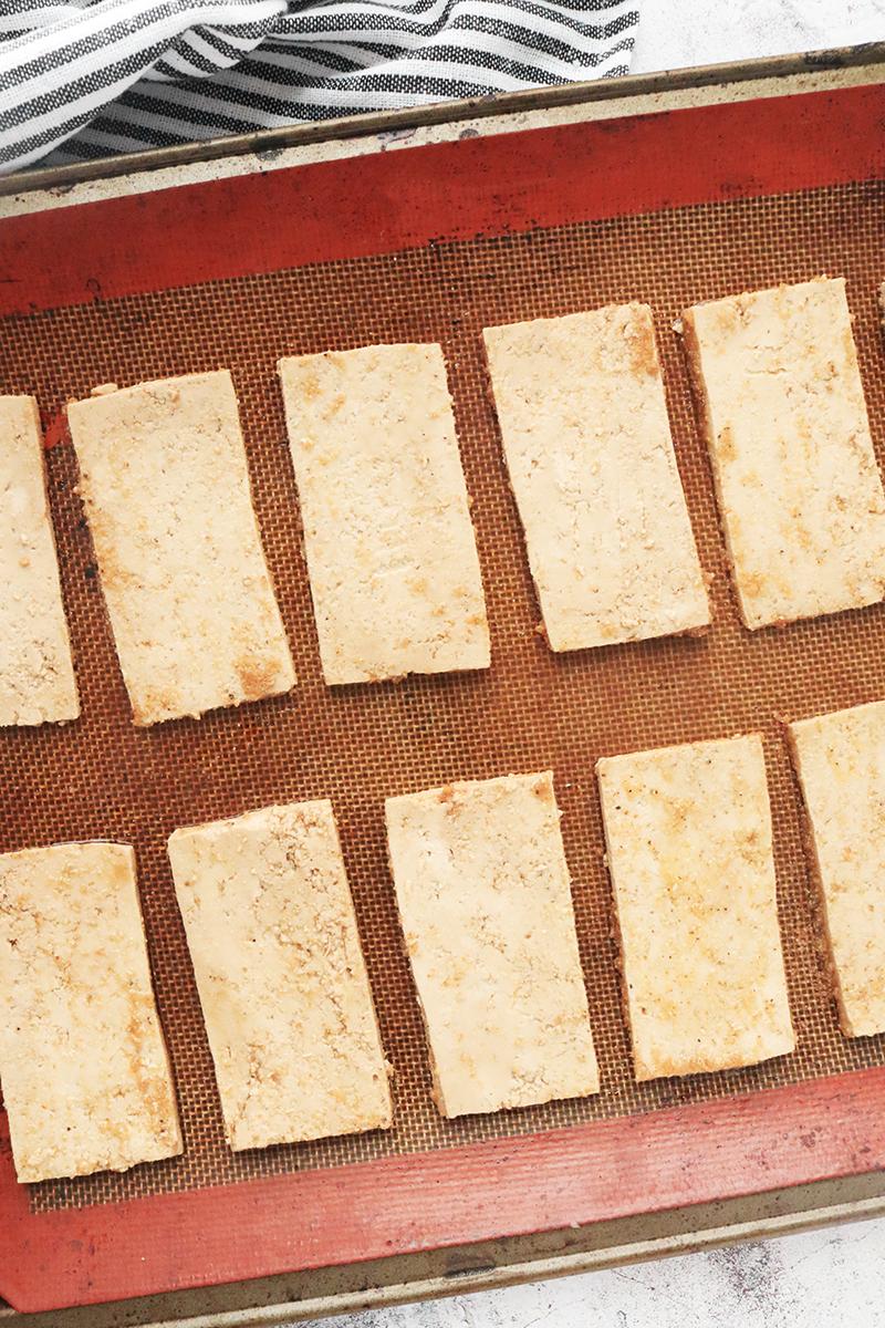 marinated tofu on a silicone baking mat