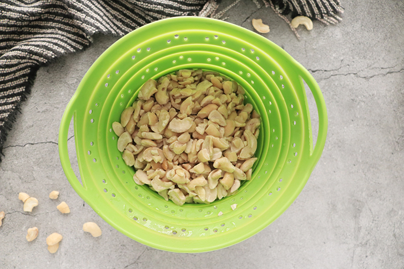 soaked and drained cashews in a colander