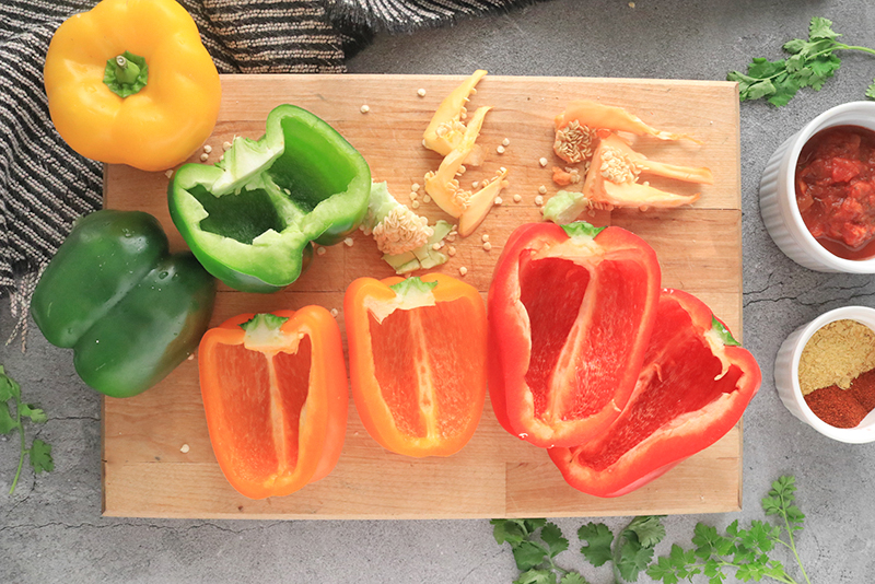 bell peppers cut in half on a cutting board