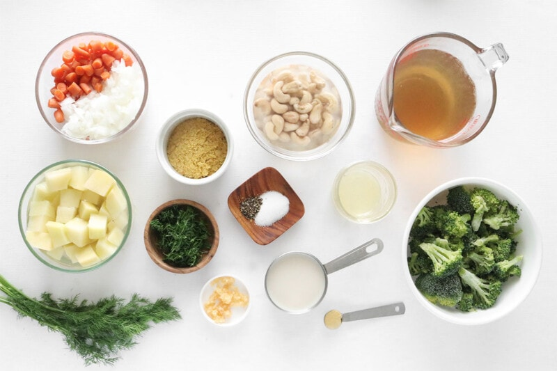 Ingredients for Cheesy Vegan Broccoli Soup on a white countertop