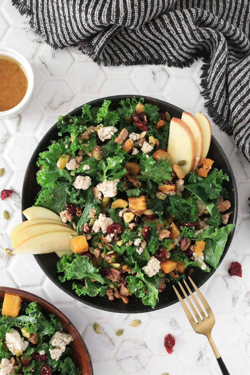 Fall Harvest Salad with Maple Vinaigrette served on a black plate