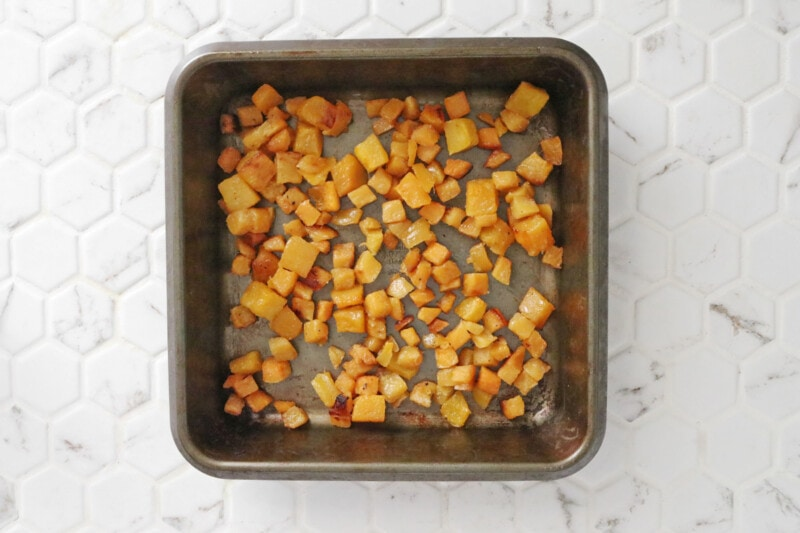 roasted butternut squash in a square metal baking pan