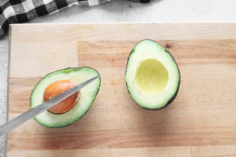 Getting the pit out of an avocado with a chef's knife