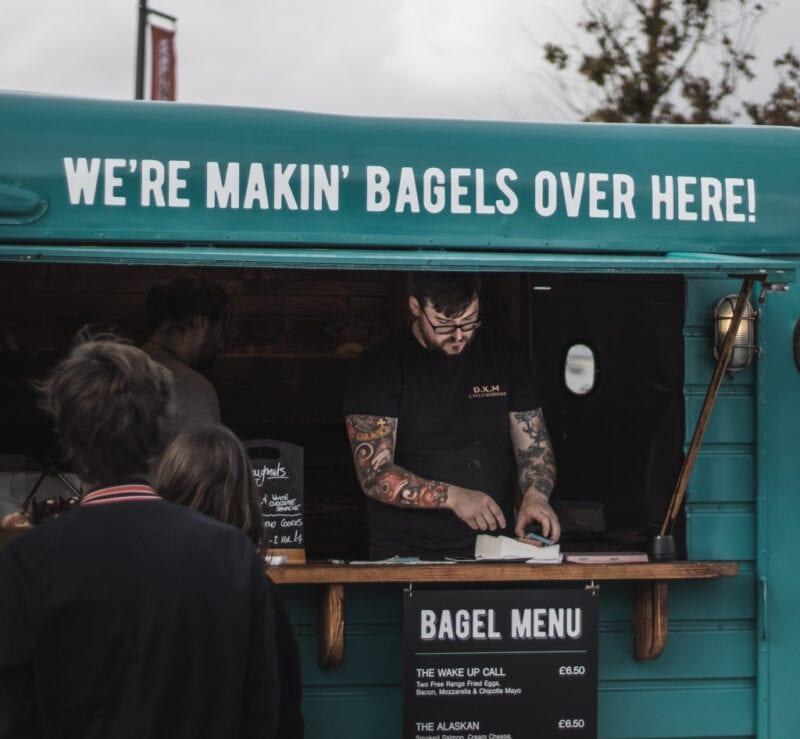 tatooed hipster making bagels