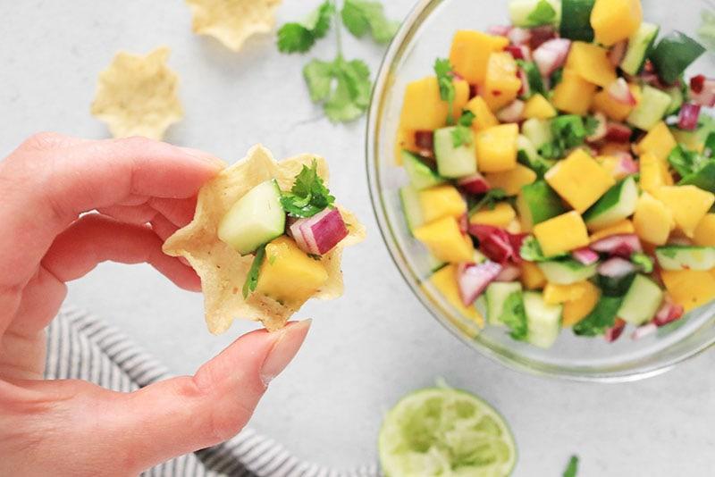 Mango Cucumber Salad on a tortilla chip