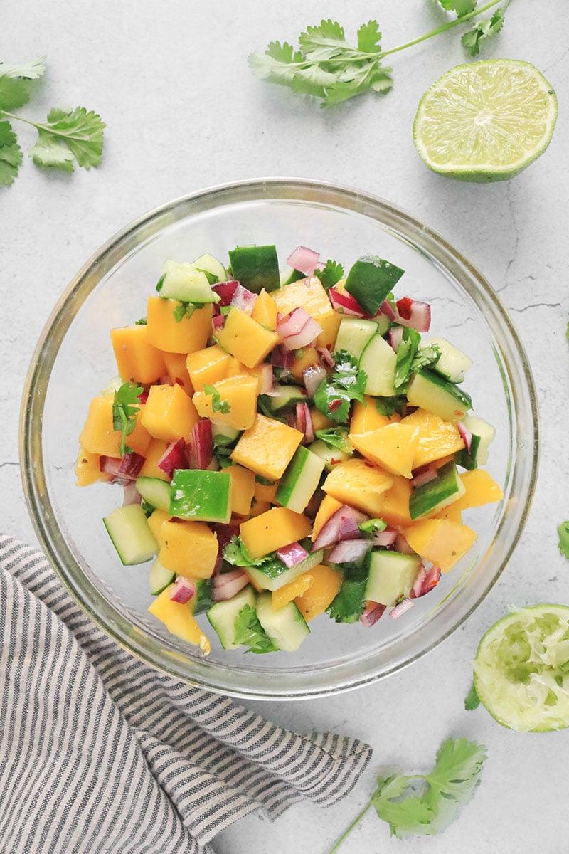 Mango Cucumber Salad in a glass bowl