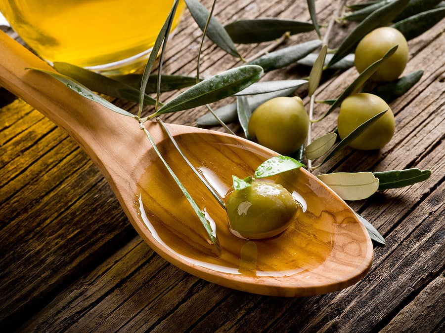 olive oil over a wooden spoon
