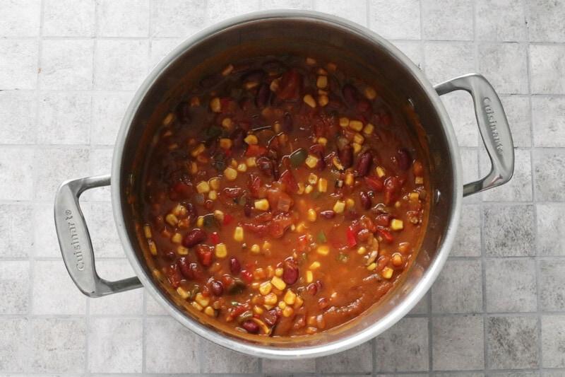 Vegan Pumpkin Chili ingredients cooking in a pot
