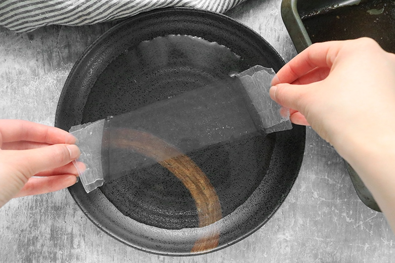 dipping rice paper into water to hydrate