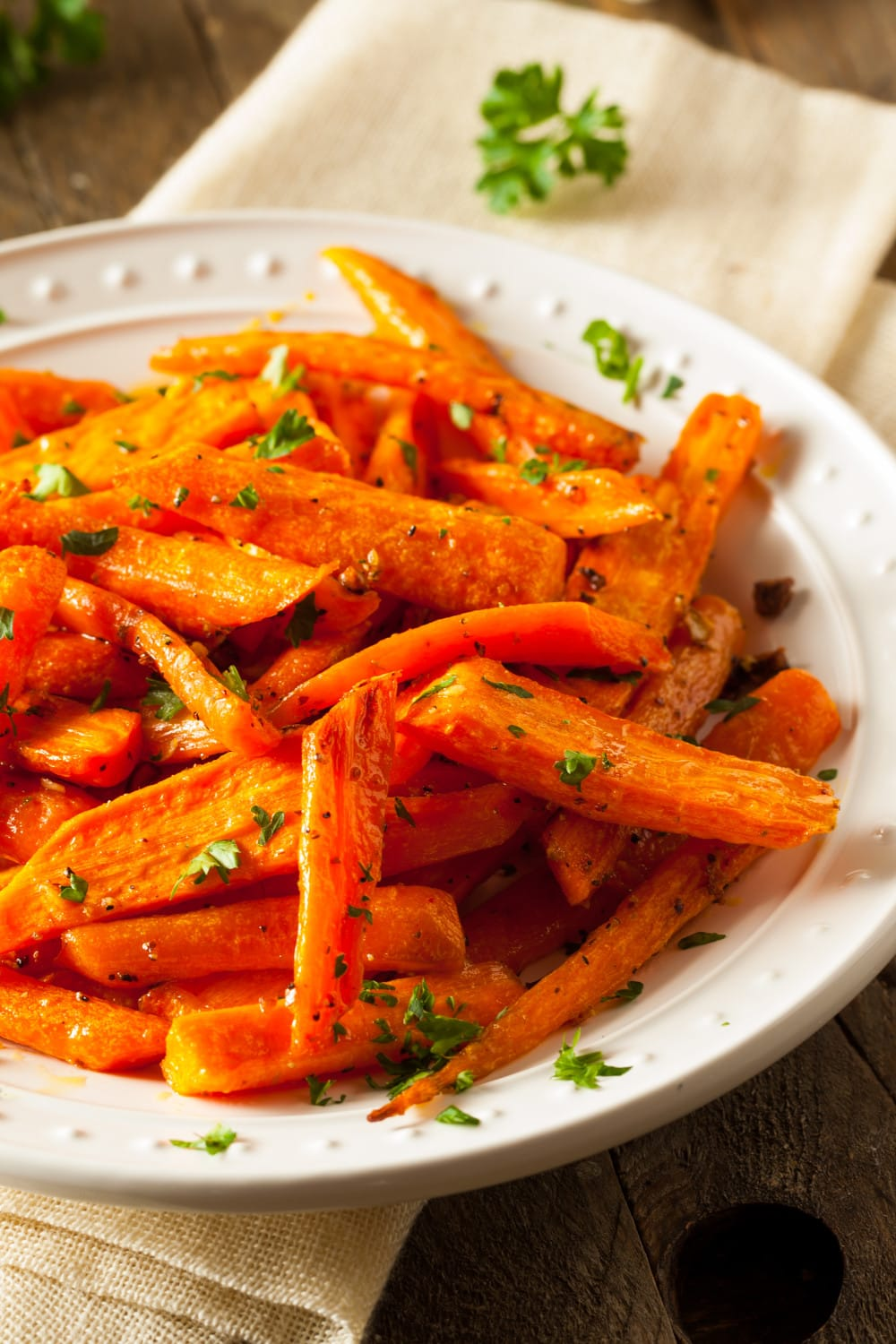 Roasted carrots on a white dish