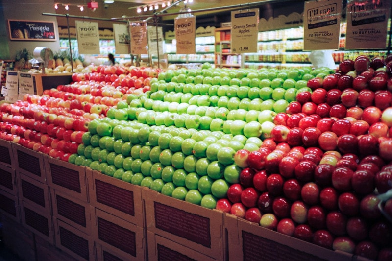 Shiny waxed apples at a grocery store