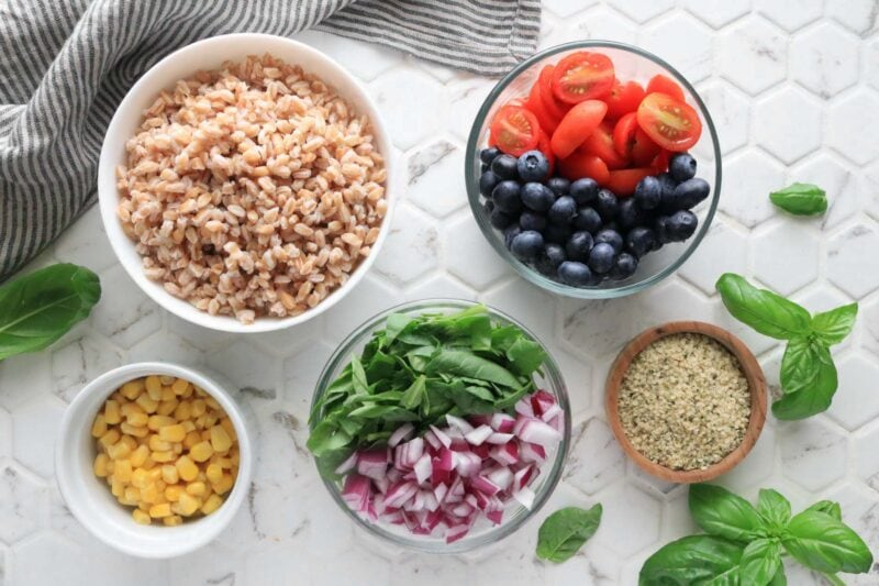 Ingredients for Summer Farro Salad one a while tile background