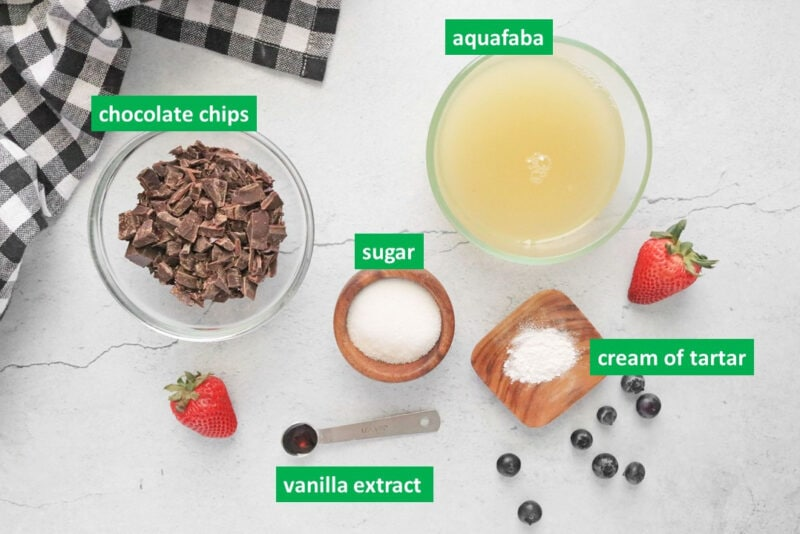 Vegan chocolate mousse ingredients with labels: chocolate chips, aquafaba, sugar, cream of tartar, and vanilla extract.
