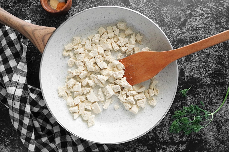 tofu cooking in a pan