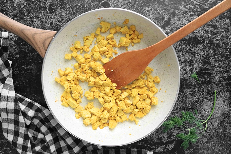 eggy tofu cooking in a pan