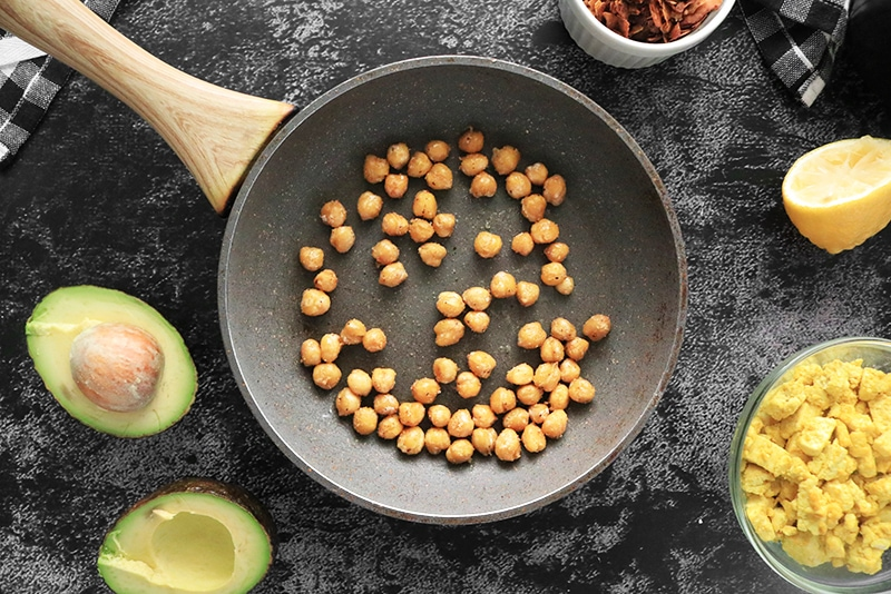 Cooking chickpeas in a pan