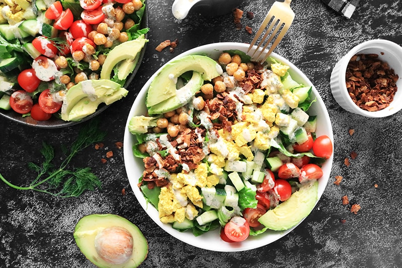 Vegan Cobb Salad with drizzled ranch dressing
