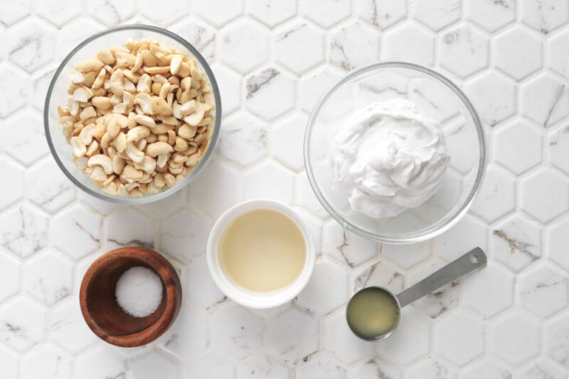 Ingredients for vegan cream cheese: cashews, coconut cream, salt, apple cider vinegar, and salt