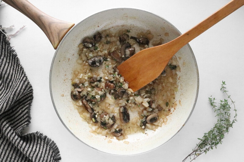 Flour added to mushroom and onion mixture in a skillet