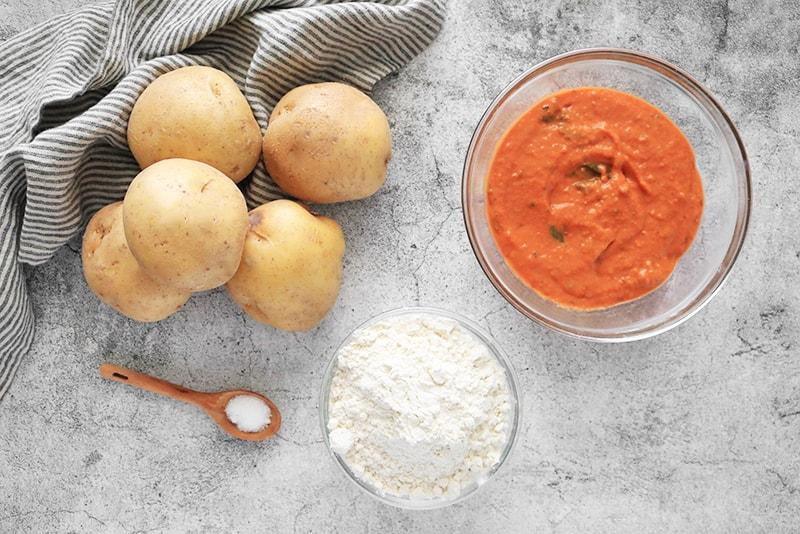 Ingredients for Vegan Potato Gnocchi: potatoes, vegan vodka sauce, flour, and salt