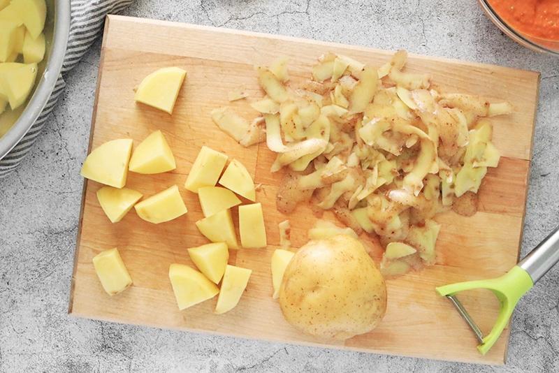 potatoes cut and peeled on a cutting board